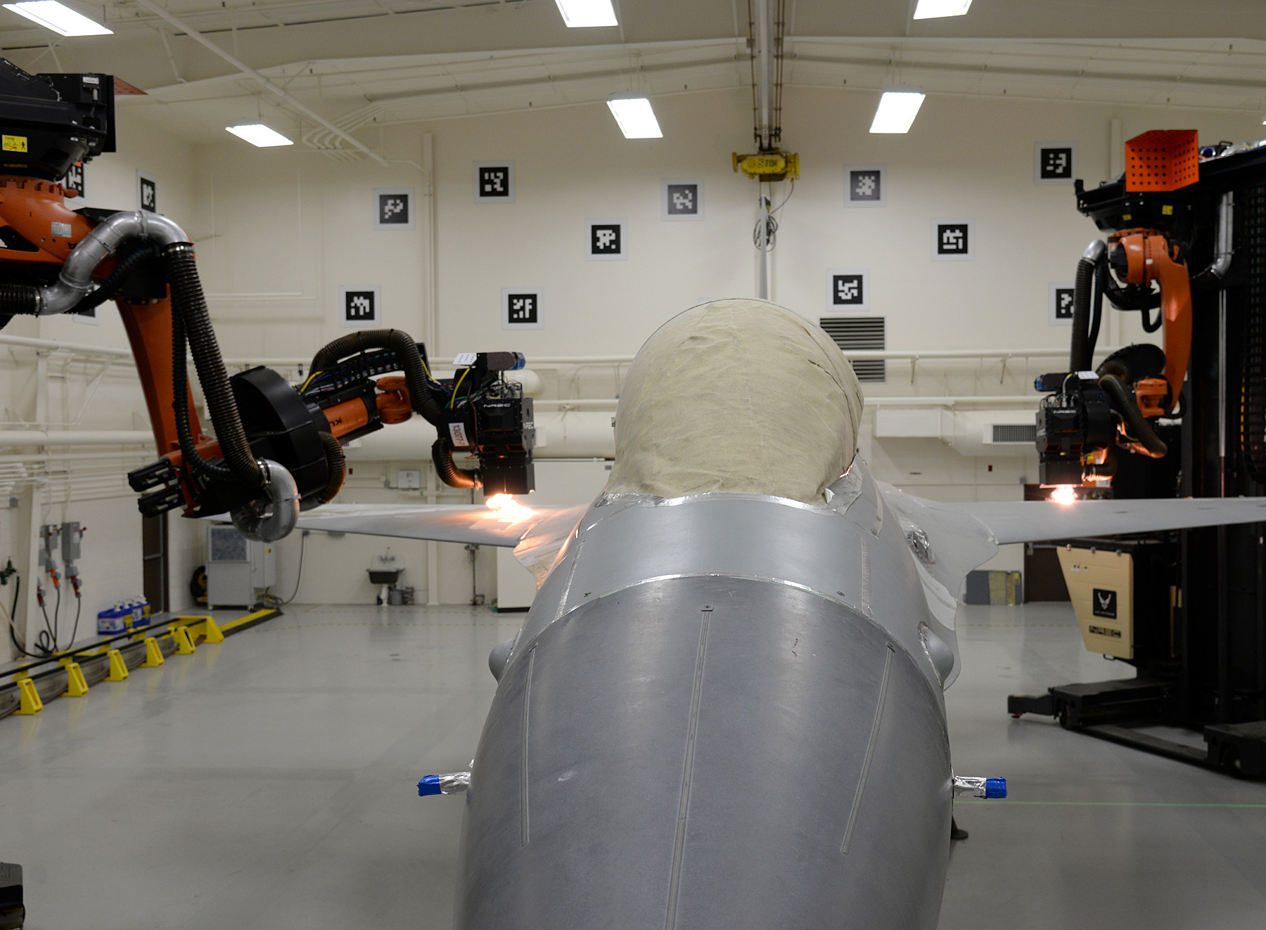 The best way to strip paint off a fighter jet? Laser-wielding robots.