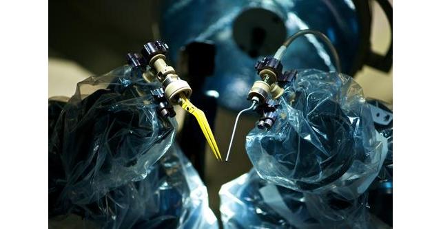 The Microscopic Future of Surgical Robotics